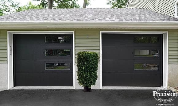 black steel garage door with long mosaic windows